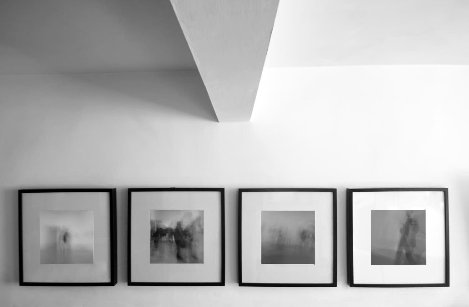 Series of four photo prints of people moving through a gallery