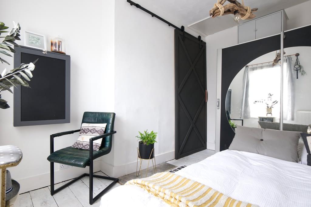 Bedroom with built in desk and sliding barn door