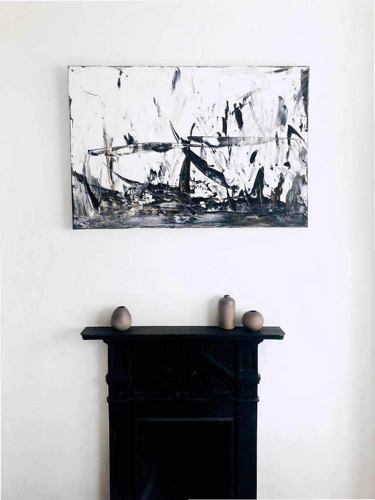 birds nest painting hanging above fireplace