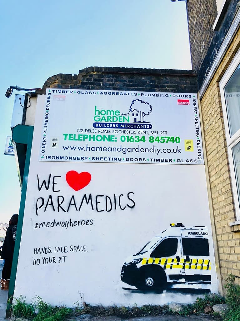 'We Heart Paramedics' shows half an ambulance coming out of the right wall. It reads 'We heart Paramedics' #medwayheroes Hands. Face. Space. Do your bit.