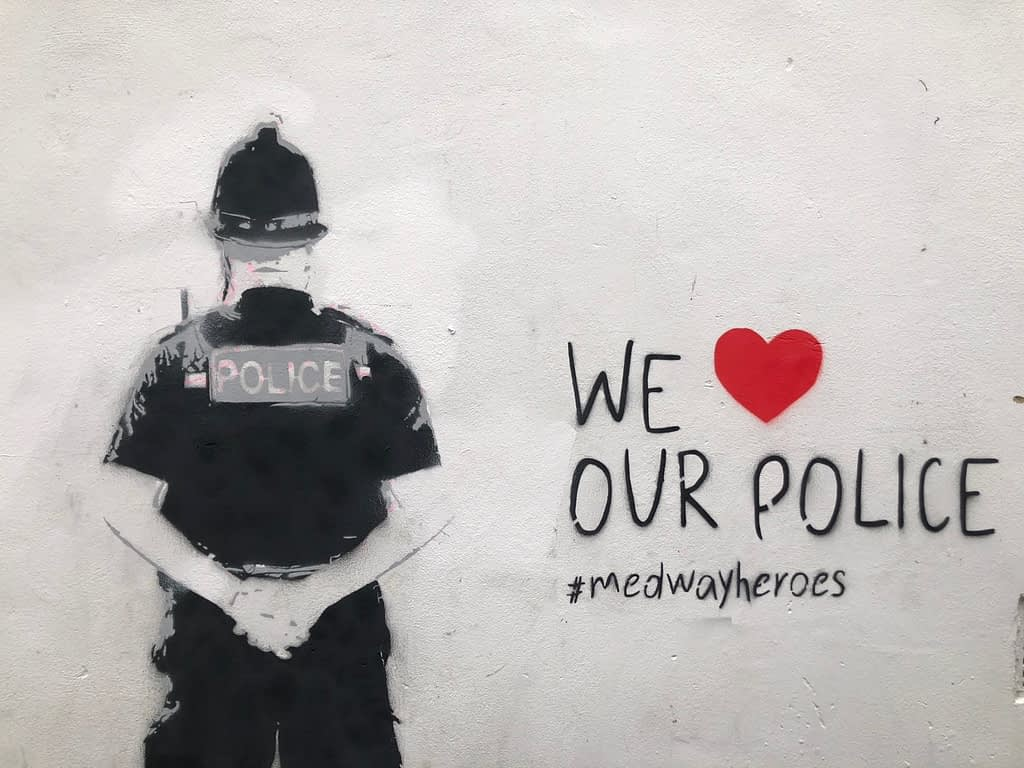 We heart our police shows a police officer from behind with 'We heart our police' #medwayheroes written to the right